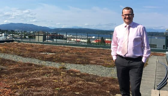 Chris Osborne, Acting Supervisor, Long Range Planning and Sustainability, Campbell River on green roof on Campbell River's City Hall
